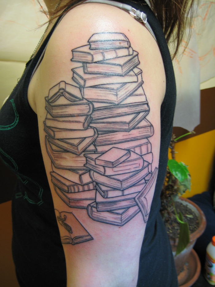 Stack of Books tattoo-photo by S. Archuleta, flickr.
