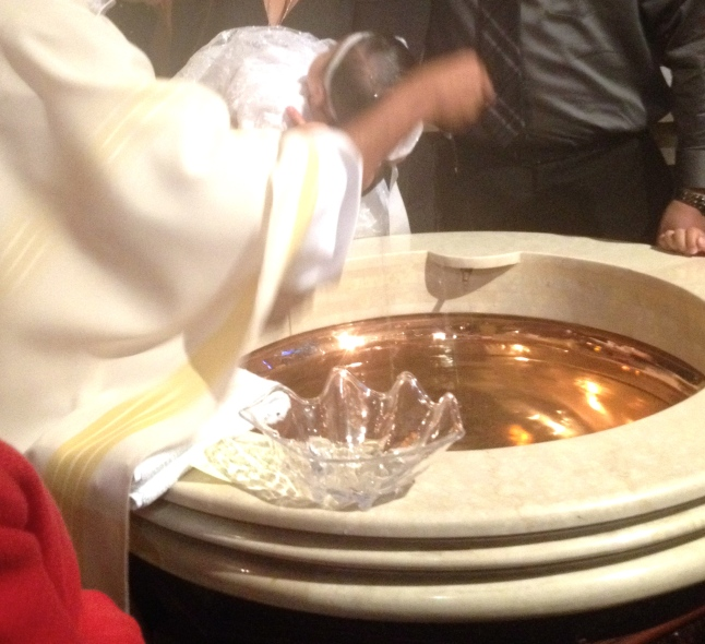At the Baptismal Font