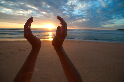 Hands holding the sunrise-gettyimages.com