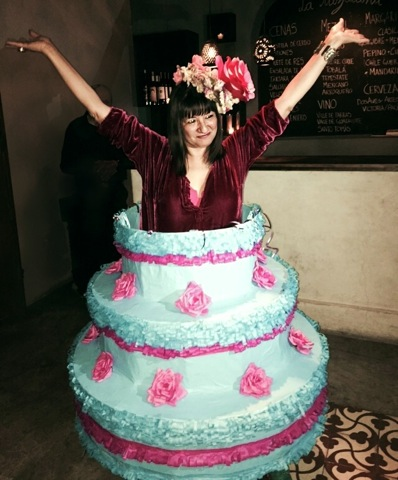 Sandra Cisneros as her own birthday cake. Piñata skirt by Eva and Jorge Rios, photo by Tracy Boyer