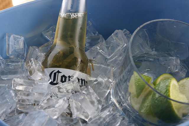 beer in ice, Corona beer, lime slices