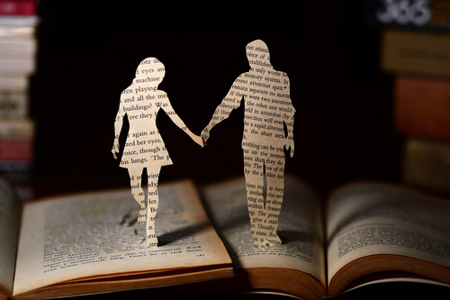 paper cutout of a couple on a book