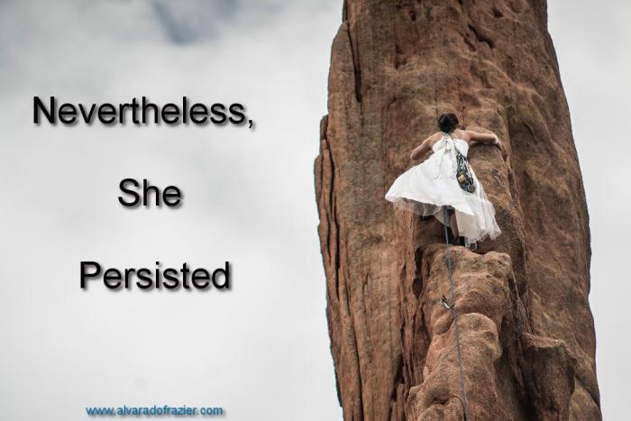 Woman in a dress climbing rock